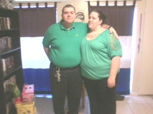 Two love birds dressed in green.